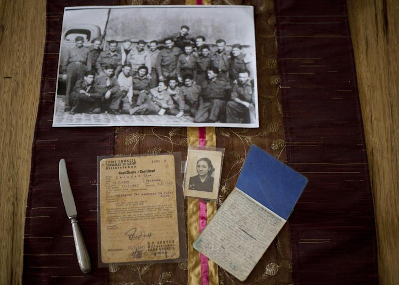 In this Thursday, April 4, 2013 photo, Warsaw ghetto Holocaust survivor Aliza Vitis-Shomron's private mementos placed on a table at her living room in Kibbutz Givat Oz, Israel. Two days before her comrades embarked on an uprising that came to symbolize Jewish resistance against the Nazis in World War II, 14-year-old Aliza Mendel got her orders: Escape from the Warsaw Ghetto. The end was near. Nazi troops had encircled the ghetto, and the remaining Jewish rebels inside were prepared to die fighting. Her job, they told her, was to survive and tell the world about how the fighters died resisting the Nazis. In the 70 years since the revolt, she's been doing just that, publishing a memoir about life in the ghetto and lecturing about the uprising. (AP Photo/Ariel Schalit)