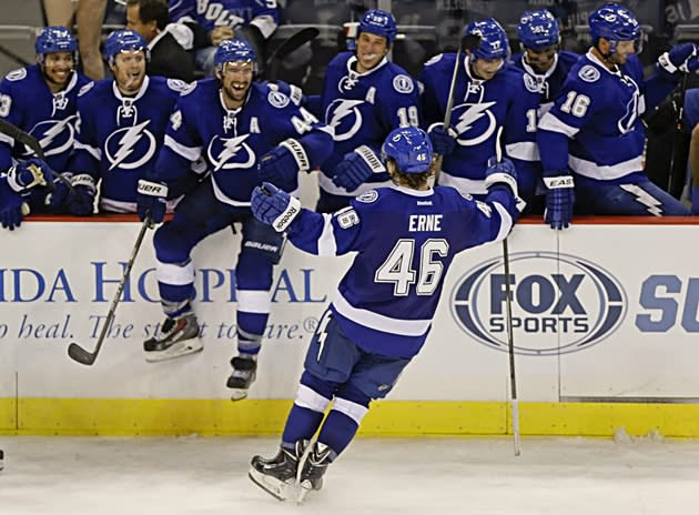 Tampa Bay's Adam Erne (46) celebrates after scoring the winner in the shootout against the St. Louis Blues on Saturday, September 15, 2013. Erne scored three goals in his return to the Quebec Remparts Sunday [AP - John Raoux]