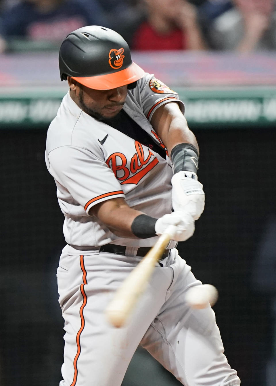Baltimore Orioles' Maikel Franco hits an RBI single during the seventh inning of the team's baseball game against the Cleveland Indians, Wednesday, June 16, 2021, in Cleveland. (AP Photo/Tony Dejak)