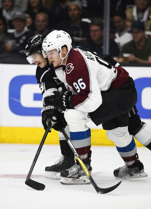 Colorado Avalanche's Mikko Rantanen, front, of Finland, and Los Angeles Kings' Dustin Brown chase the puck during the second period of an NHL hockey game, Monday, April 2, 2018, in Los Angeles. (AP Photo/Jae C. Hong)
