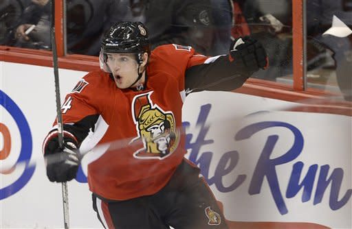 Ottawa Senators center Colin Greening celebrates his goal in the final seconds of second period NHL action in Ottawa, Monday March 25, 2013. (AP Photo/The Canadian Press, Adrian Wyld)