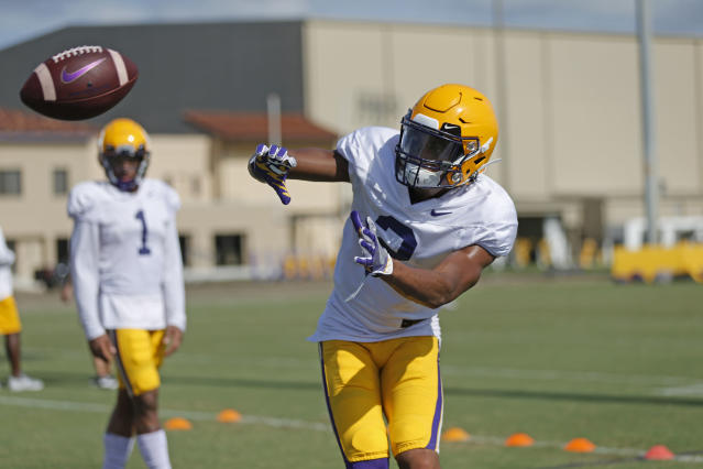 LSU wide receiver Justin Jefferson (2) works out during their NCAA college football practice in Baton Rouge, La., Wednesday, Aug. 7, 2019. (AP Photo/Gerald Herbert)