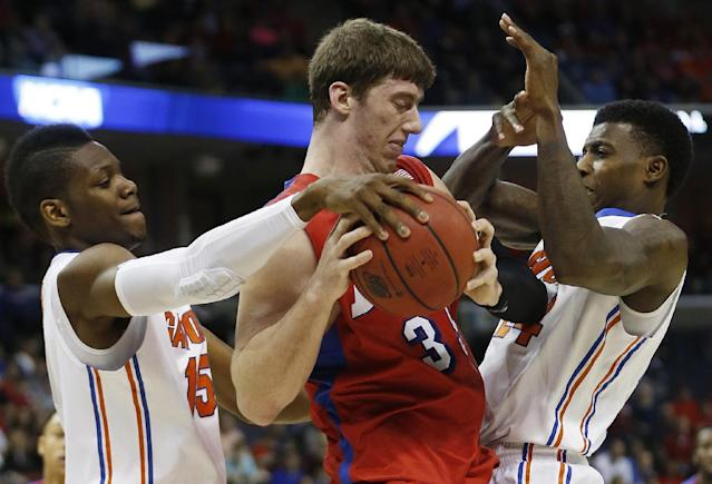 Florida's Will Yeguete, left and Casey Prather defense against Dayton's Matt Kavanaugh (35) during the first half in a regional final game at the NCAA college basketball tournament, Saturday, March 29, 2014, in Memphis, Tenn. (AP Photo/John Bazemore)