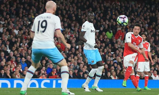 "<span class=""element-image__caption"">Mesut Özil fires a curling left-footed towards goal to give Arsenal the lead against West Ham.</span> <span class=""element-image__credit"">Photograph: Michael Zemanek/BPI/Rex/Shutterstock</span>"