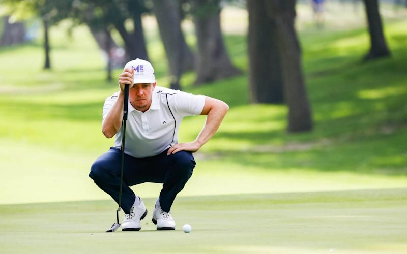 Jonas Blixt lines up a putt on the fifth hole - USA TODAY Sports