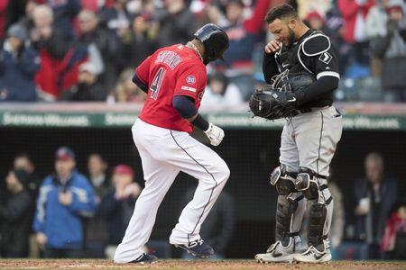 Apr 1, 2019; Cleveland, OH, USA; Cleveland Indians first baseman Carlos Santana (41) scores on an RBI walk as Chicago White Sox catcher Welington Castillo (21) reacts during the eighth inning at Progressive Field. Mandatory Credit: Ken Blaze-USA TODAY Sports