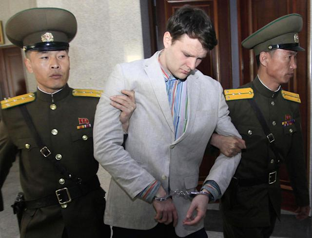 <p>U.S. student Otto Warmbier is escorted at the Supreme Court in Pyongyang, North Korea, March 16, 2016. (Photo: Jon Chol Jin/AP) </p>