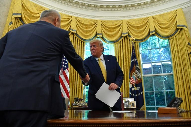 Vice Premier of the People's Republic of China Liu He shakes hands with US President Donald Trump