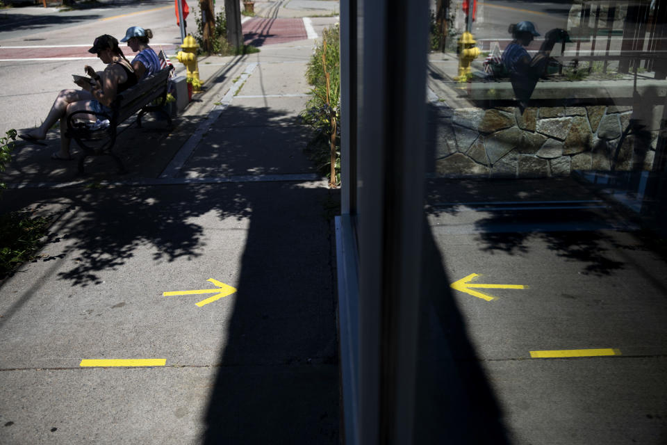 Tape marks social distance spots for customers outside one of two Brickley's Ice Cream shops which closed for the season after teenage workers were harassed by customers who refused to wear a mask or socially distance, in Wakefield, R.I., Wednesday, July 29, 2020. Disputes over masks and mask mandates are playing out at businesses, on public transportation and in public places across America and other nations. (AP Photo/David Goldman)