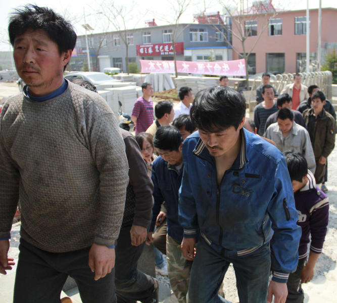 In this Monday May 21, 2012 photo, Chinese fishing crew members line up to enter a hospital for medical check-ups after 13 days in North Korean custody at a harbor in Dalian, in northeastern China's Liaoning province. China's leadership is hitting a rough patch with ally North Korea under its new leader Kim Jong Un, as Beijing finds itself wrong-footed in episodes including Pyongyang's rocket launch and the murky detention of Chinese fishing boats. (AP Photo) CHINA OUT