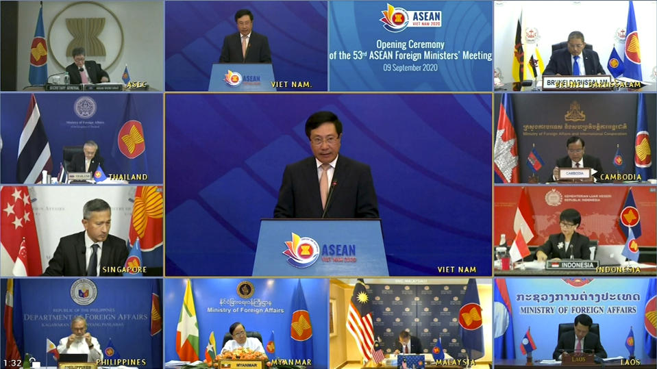 This image taken from video provided by VTV shows ASEAN foreign ministers watching Vietnamese Foreign Minister Pham Binh Minh, center, delivering a speech in Hanoi, Vietnam, during the opening of ASEAN Foreign Ministers' Meeting on Wednesday, Sept. 9, 2020. Southeast Asia's top diplomats are holding their annual talks by video Wednesday to discuss the immense crisis wrought by the coronavirus pandemic and rising tensions in the South China Sea amid the escalating rivalry between Washington and Beijing. (VTV via AP)