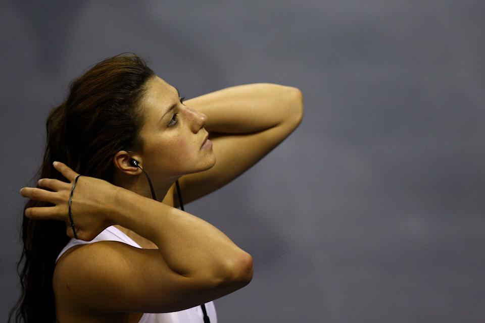 SHANGHAI, CHINA - JULY 23: Stephanie Rice of Australia ties her hair back prior to putting on her cap during a swimming training session on Day Eight of the 14th FINA World Championships at the Crown Indoor Stadium on the grounds of the Oriental Sports Center on July 23, 2011 in Shanghai, China. (Photo by Quinn Rooney/Getty Images)