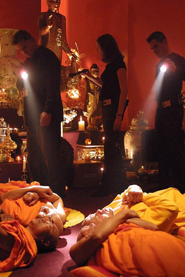 """Grissom, Sara (Jorja Fox), and Nick (George Eads) investigate the murders of four monks who were shot while chanting in a Buddhist temple. (""""Felonious Monk"""" 3/7/2002, Season 2)"""