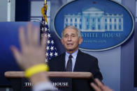 Dr. Anthony Fauci, director of the National Institute of Allergy and Infectious Diseases, takes questions as he speaks with reporters in the James Brady Press Briefing Room at the White House, Thursday, Jan. 21, 2021, in Washington. (AP Photo/Alex Brandon)