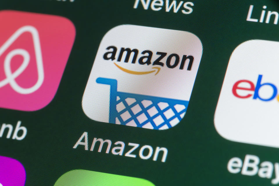 London, UK - July 31, 2018: The buttons of the online shopping app Amazon, surrounded by Airbnb, ebay, News and other apps on the screen of an iPhone.
