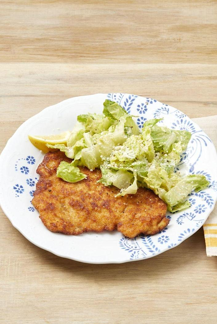 """<p>Try this twist on chicken Milanese for a delicious summer comfort food dinner.</p><p><strong><a href=""""https://www.thepioneerwoman.com/food-cooking/recipes/a32530100/chicken-caesar-milanese-recipe/"""" rel=""""nofollow noopener"""" target=""""_blank"""" data-ylk=""""slk:Get the recipe."""" class=""""link rapid-noclick-resp"""">Get the recipe.</a></strong> </p>"""