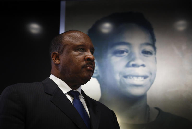 Inglewood Mayor James Butts stands in front of a photo of William Tillett during a news conference Wednesday, Feb. 20, 2019, in Inglewood, Calif. Authorities say a 50-year-old man is in custody in connection with the kidnapping and killing of then 11-year-old Tillett in Southern California nearly three decades ago. (AP Photo/Jae C. Hong)