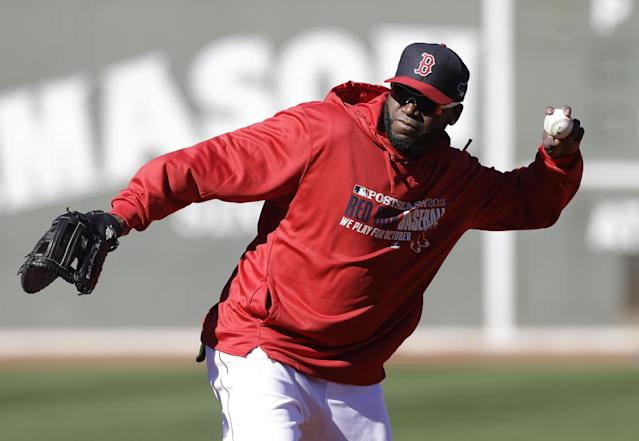 Boston Red Sox's David Ortiz throws the ball while warming during a baseball workout at Fenway Park in Boston, Tuesday, Oct. 1, 2013. The Red Sox host Game 1 of the AL division series on Friday, Oct. 4, against the winner of Wednesday's wild-card playoff game between the Cleveland Indians and Tampa Ray Rays. (AP Photo/Steven Senne)