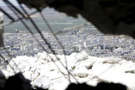 A general view shows the northern town of Ariha, one of the last government strongholds in the Idlib province, as seen from the rebel-held area of Jabal al-Arbaeen May 26, 2015. REUTERS/Khalil Ashawi