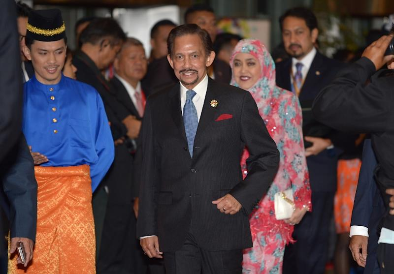 The all-powerful Sultan Hassanal Bolkiah, one of the world's richest men, announced last year he would push ahead with the introduction of sharia law, eventually including tough penalties such as death by stoning or severed limbs (AFP Photo/Mohd Rasfan)
