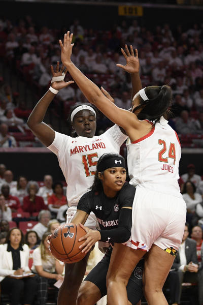 Maryland guard Ashley Owusu (15) and forward Stephanie Jones (24) defend against South Carolina guard Destanni Henderson, center, during the first half of an NCAA college basketball game, Sunday, Nov. 10, 2019, in College Park, Md. (AP Photo/Nick Wass)