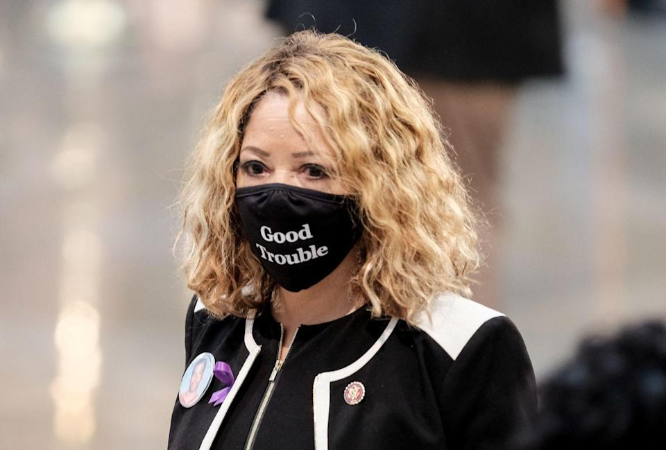 "<p>Representative Lucy McBath (D-GA) entered the memorial service. Many attendees, McBath included, chose to wear face masks reading ""Good Trouble,"" a term coined by Lewis himself. </p>"