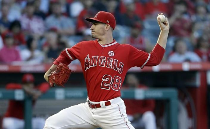Los Angeles Angels starting pitcher Andrew Heaney throws to a Houston Astros batter during the first inning of a baseball game Tuesday, July 16, 2019, in Anaheim, Calif. (AP Photo/Marcio Jose Sanchez)