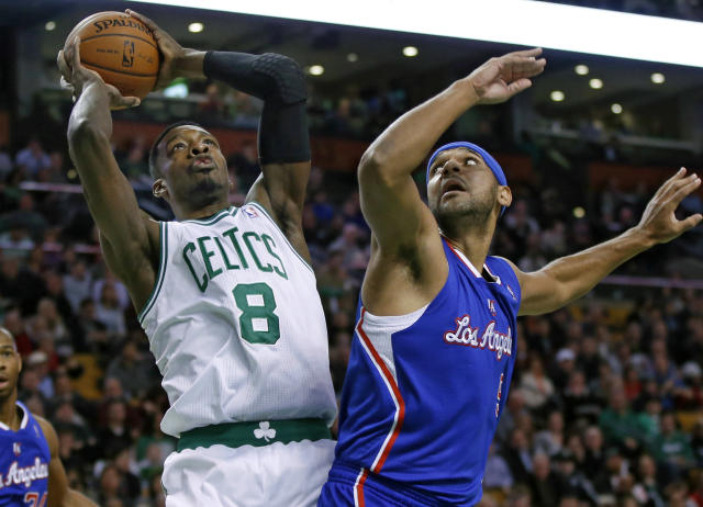 Boston Celtics guard Jeff Green (8) shoots against Los Angeles Clippers forward Jared Dudley in the first quarter of an NBA basketball game in Boston, Wednesday, Dec. 11, 2013. (AP Photo/Elise Amendola)