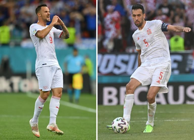 Haris Seferovic (L) has been a key player for Switzerland at Euro 2020, while Sergio Busquets returned to captain Spain after missing the first two games with Covid-19