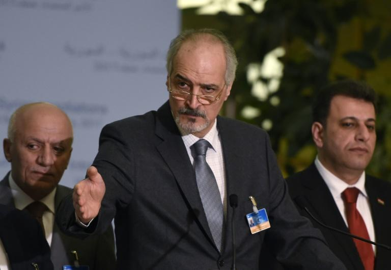 Syrian chief negotiator Bashar al-Jaafari (C), Ambassador of the Permanent Representative Mission of Syria to UN New York, speaks at a press conference on the Intra-Syria peace talks at the Palais des Nations in Geneva on March 2, 2017
