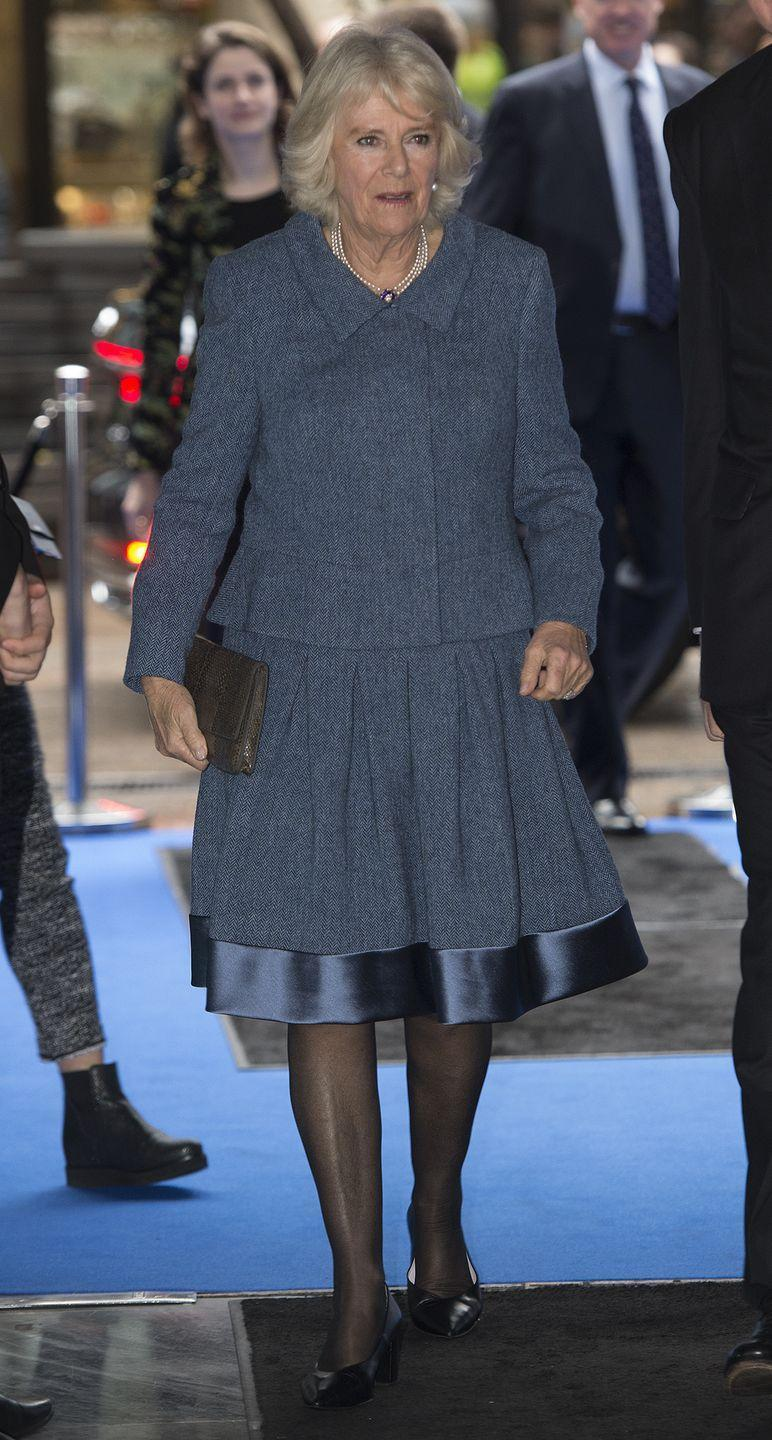 <p>Camilla wore a silk hemmed blue suit to visit ICAP for their 26th annual Charity Day. The Duchess paired the look with a pearl and sapphire necklace, drop earrings, and a brown clutch. </p>