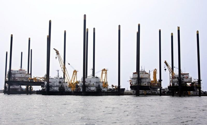"FILE PHOTO: Boats known as ""jack-up"" rigs are docked in Lake Charles, Louisiana in the aftermath of Hurricane Rita"