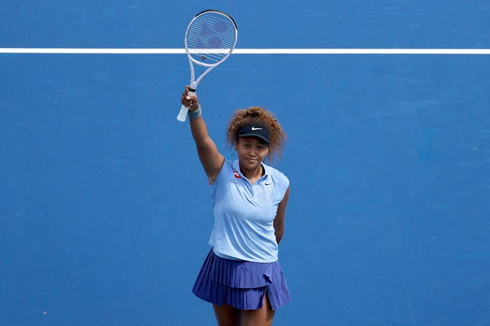 Naomi Osaka (pictured) celebrates after defeating Cori Gauff 6-4, 3-6, 6-4 during Western & Southern Open.