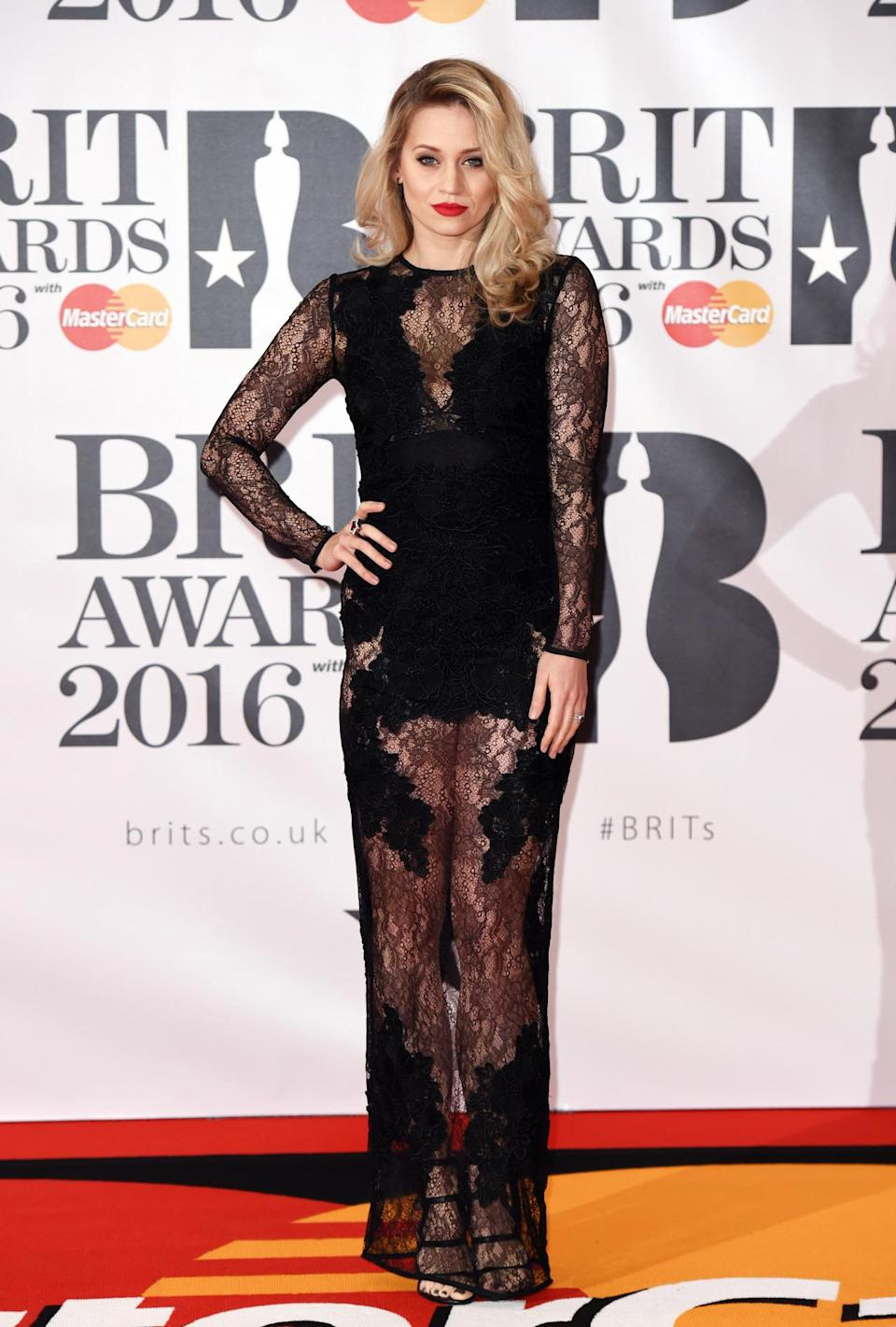 <p>The former Pussycat Dolls singer opted for a semi-sheer number. <i>[Photo: Rex]</i></p>