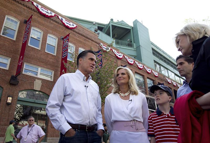 "FILE - In this April 16, 2012 file photo, Republican presidential candidate, former Massachusetts Gov. Mitt Romney and his wife Ann, are seen outside Fenway Park baseball stadium in Boston. Don't bet on Mitt Romney winning his home state. Or even trying. ""That's not been a topic of discussion,"" Romney campaign adviser Kevin Madden said when asked if the Republican former Massachusetts governor would compete in the heavily Democratic state.   (AP Photo/Steven Senne)"
