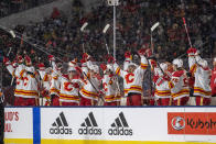 The Calgary Flames celebrate a goal against the Winnipeg Jets during the second period of an NHL Heritage Classic outdoor hockey game in Regina, Canada, Saturday, Oct. 26, 2019. (Liam Richards/The Canadian Press via AP)