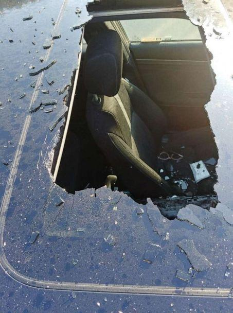 PHOTO: damage to a car roof from an exploding dry shampoo can (Christine Bader Debrecht/Facebook)