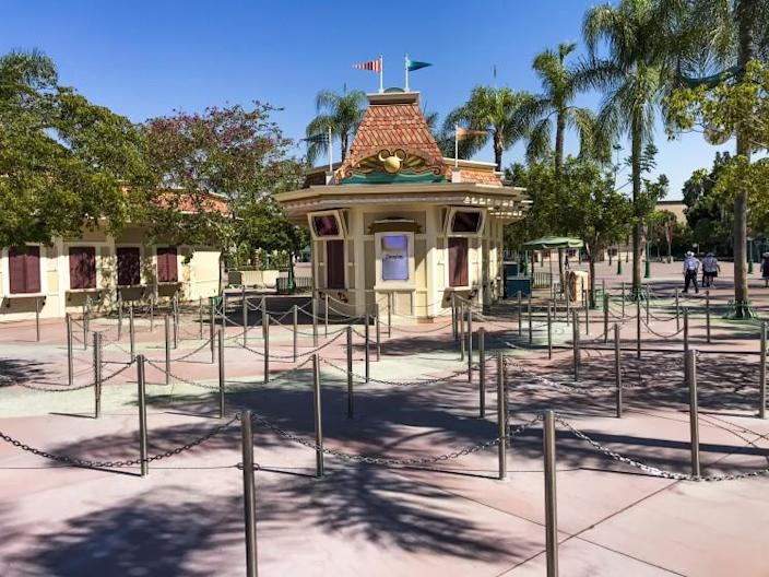 ANAHEIM, CA - SEPTEMBER 30: Stanchions that normally direct long lines remain empty at the Disneyland Park ticket booth while Disneyland remains closed on Wednesday, Sept. 30, 2020 in Anaheim, CA. After suffering losses for months due to Gov. Newsom's mandatory coronavirus shut-down, Disney says it will lay off 28,000 employees across its parks, experiences and consumer products segment.(Allen J. Schaben / Los Angeles Times)