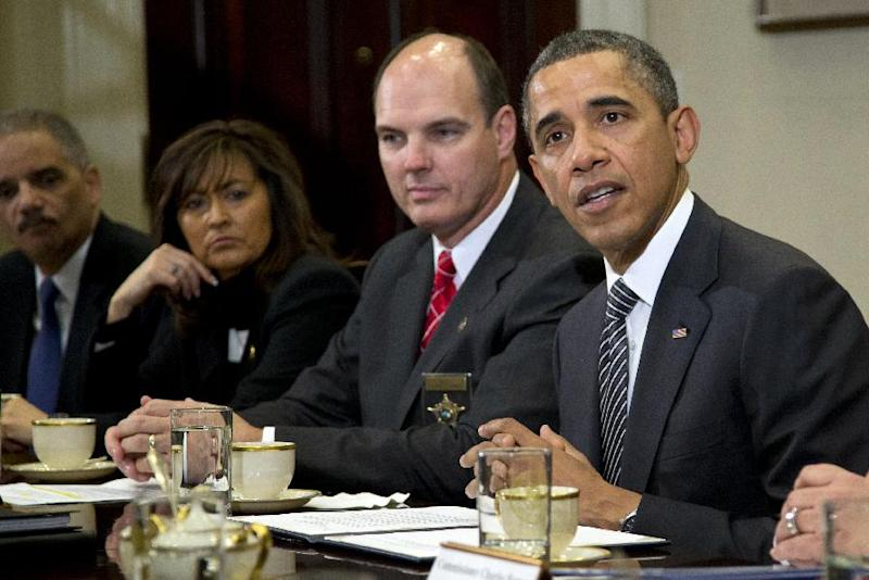President Barack Obama meets with  representatives from Major Cities Chiefs Association and Major County Sheriffs Association in the Roosevelt Room of the White House, Monday, Jan. 28, 2013, in Washington, to discuss policies put forward by President Obama to reduce gun violence. From left are U.S. Attorney General Eric Holder, Minneapolis Police Chief Janee Harteau and Hennepin County Minnesota Sheriff Richard W. Stanek . (AP Photo/Carolyn Kaster)