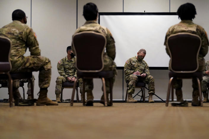Sergeant Major of the Army Michael Grinston, second from right, gets feedback from soldiers about their concerns at Fort Hood, Texas, Thursday, Jan. 7, 2021. Following more than two dozen soldier deaths in 2020, including multiple homicides, the U.S. Army Base is facing an issue of distrust among soldiers. (AP Photo/Eric Gay)