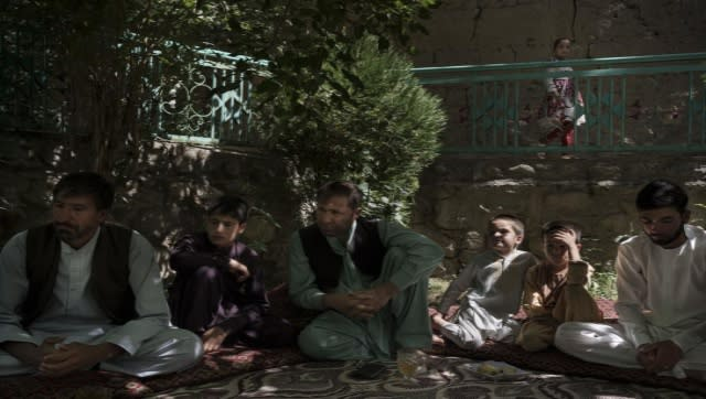 Painda Mohammed, left, sits with family members at their house's yard near Kabul on Friday, 17 September, 2021. AP