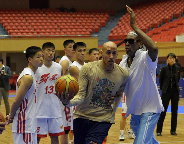 Former NBA basketball star Rodman takes part in a practice session with North Korean basketball players in Pyongyang