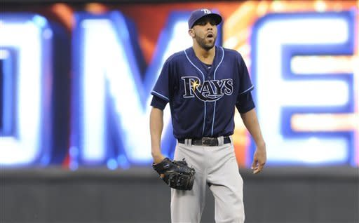 Tampa Bay Rays pitcher David Price reacts after giving up a solo home run to Minnesota Twins' Brian Dozier in the fifth inning of a baseball game Saturday, Aug. 11, 2012 in Minneapolis. (AP Photo/Jim Mone)
