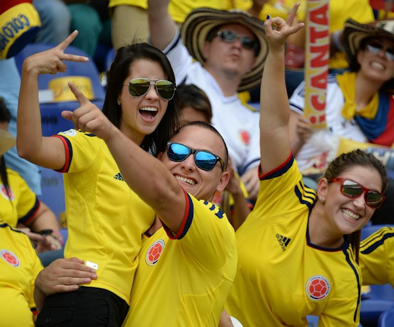 Soccer fans in this picture from 2013 cheer on the national team of Colombia, where demobilized FARC rebels want to form a professional football team