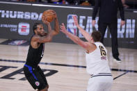 Los Angeles Clippers forward Kawhi Leonard (2) shoots over Denver Nuggets center Nikola Jokic (15) during the second half of an NBA conference semifinal playoff basketball game Tuesday, Sept. 15, 2020, in Lake Buena Vista, Fla. (AP Photo/Mark J. Terrill)