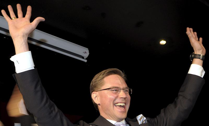National Coalition party leader and Prime Minister Jyrki Katainen listens to the results of the preliminary votes at the party's reception in Helsinki, Finland on Sunday Oct. 28, 2012. The Finns went to the polls in local elections on Sunday. (AP Photo / LEHTIKUVA /   Markku Ulander)  FINLAND OUT