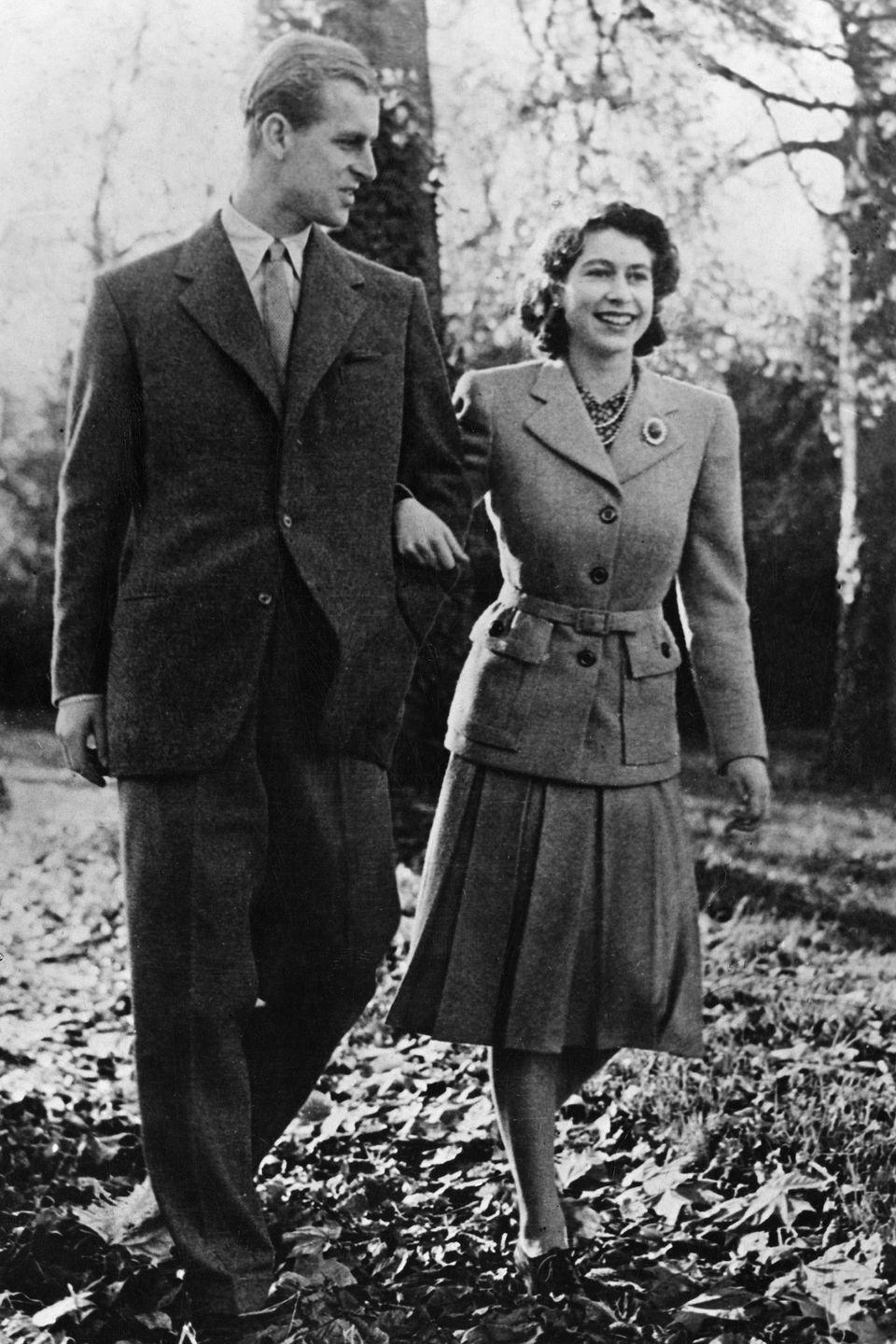 <p>The newly-married couple walk the grounds of Broadlands, Romsey, where they were enjoying their first trip together. </p>