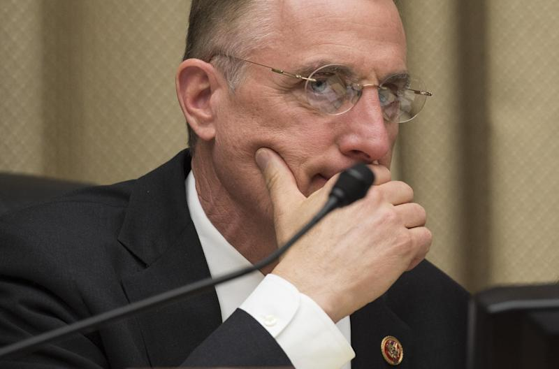 Chairman of the House Energy and Commerce Committee Congressman Tim Murphy listens to during a hearing on Capitol Hill in Washington, DC, April 1, 2014 (AFP Photo/Jim Watson)