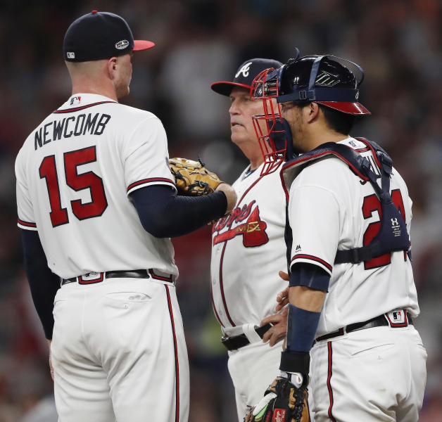 Atlanta Braves manager Brian Snitker (43) relives pitcher Sean Newcomb (15) during the third inning in Game 3 of MLB baseball's National League Division Series against the Los Angeles Dodgers, Sunday, Oct. 7, 2018, in Atlanta. (AP Photo/John Bazemore)
