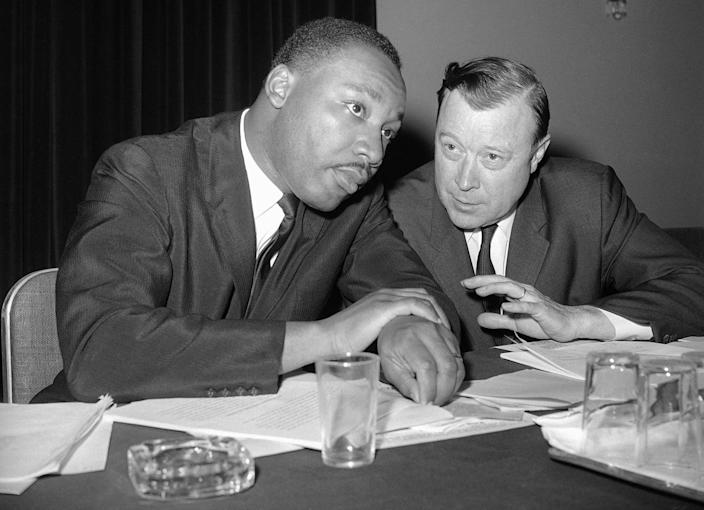 <p>The Rev. Martin Luther King, Jr., president of the Southern Christian Leadership Conference, left, and Walter Reuther, president of the United Auto Workers Union, are shown together at meeting of African American leaders at the Roosevelt Hotel in New York, July 2, 1963. (AP Photo) </p>